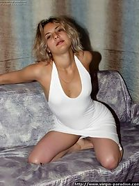 Pretty virgin blonde takes off her innocent looking white cloths