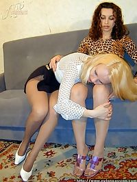 Two horny lesbians caress each others pussies through ripped nylon