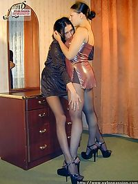 Horny nyloned lesbians kissing and undressing and making love