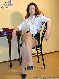 Redhead teacher in nylon stockings striping and showing lingerie