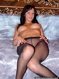 Hottie in nylons showing her tits and her pussy
