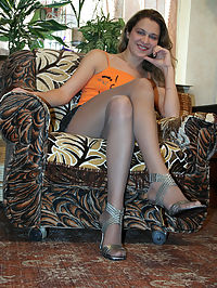 Sexy redhead girl pleasing herself with pantyhose