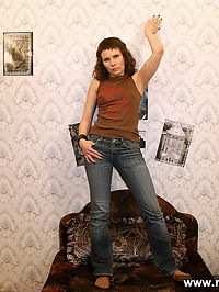 Sexy brunette wears jeans and pantyhose