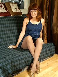 Redhead girl takes pantyhose pleasure