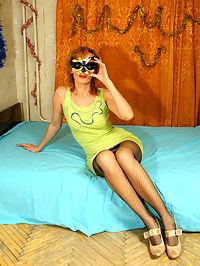 Girl poses in fishnet black pantyhose