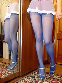 Redhead teen girl poses in blue pantyhose