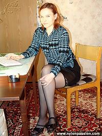 Teen girl pleases herself wearing stockings