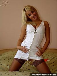 Teen blonde girl masturbates in stockings
