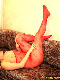 Blonde in red pantyhose rubs her hot pussy for us