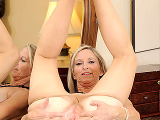 Annabelle Brady takes off her sexy gown and spreads her milf pussy on top of the vanity