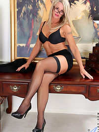 Horny mature secretary flaunts her naked body atop her desk