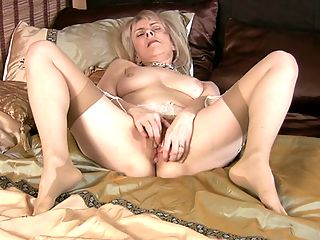 Blonde granny pulls anal beads out of her hairy pussy