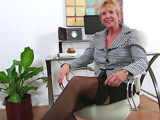 Blue eyed granny takes off her sheer bra and panties to masturbate