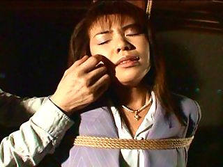 Bound and gagged Asians.