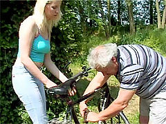Sandra and Bruce : Blonde babe rimming an older senior his butthole outdoor