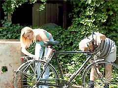 Sandra and Bruce : Senior guy helping a blonde teenie with her broken bike
