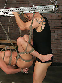 MILF Val Malone dungeon fucked. : One of our slave peddlers brought a couple of new girls by the studio and we decided that Val was a good candidate for us, so we took her off his hands. Ogre and I carry her into the Dungeon and undress her to reveal her hot little body. We have a little fun with her before we tie her and get her ready for Derrick. Im not sure if she completely understood what was going on, but she has one thing going for her, she learns fast. We put her in several different positions, always keeping this whore ready for the things she is good at...fucking, sucking, and having cum dumped on her body. Rest assured that you will see more of this one