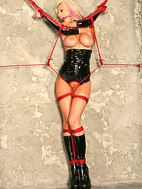 Big tit Tanya tied to the wheel and cumming : Beautiful Tanya poses for us as we tie her in red rope and remove her clothing. Her beautiful tits and body serve as perfect fodder for our dastardly plans. Once Tanya is gagged we tie her tightly to the wheel and harness the magic wand to her smooth pussy and flip the switch. Tanyas heaving breasts create a beautiful sight as she begins to submit and mashes her cunt down hard on the vibes head until she has a colossal orgasm session.