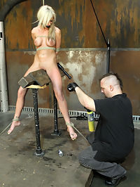 Cute little Kaylee Hilton whipped and cumming! : We bring back the tall and lean Kaylee Hilton...Kaylee is a young woman, but allready understands what BDSM is about...the inner struggle to endure...the submission of the will to the current predicament...she has proven herself but strives yet to challenge herself again...such a great spirit...Bane rigs her in a suspension that leaves Kaylee hanging in the air with her legs spread...and he gives her much attention...clothespins, pussy stretching and heavy nipple clamps...then he really goes to work on her...he gives her no breaks and moves right onto a wooden pony ride...she writhes not only from the torments he brings to her feet, thighs and tits, but also from every movement she takes to deal with its continuance...the slow woe of the wooden pony definitely takes its toll on our lovely model...then bent over for an anal dildo fucking...Bane gives her the vibe as he flogs her...Kaylee is totally spent...Bane rigs her down on a bench with pussy and ass exposed...he takes the last bit that she has to give...a very tough day for a very hot girl...Ogre...
