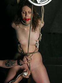 Forced Orgasms! : Kristine is a 247 slave and her Master brought her to us to work on her pain tolerance. She has been taught to keep her screams to a minimum, but I still find ways to get them out of her. She endures several intense ties that dealt with heavy pussy torture and a suspension that tilted her body just enough to compromise her breathing. I kept the pain level at high the entire day and the orgasms the same way. She has an amazing talent, which is she can cum on demand, so I used that to my advantage all day....
