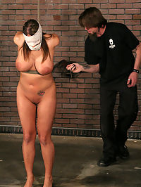 Massive tits tied and whipped! : Trina likes to be pushed and she likes the feeling when pain and pleasure meet. As we watch her struggle, The Pope instantly targets her massive tits and toys with them before he wraps her head in gauze. Trina then falls into a state of submission as The Pope has his way with her voluptuous body. Loud screams fill the air as Trina is bound tightly and made to cum. Put through her paces, Trina serves her Master well as he works her cunt and wrings her body dry of every last orgasm it has in it.