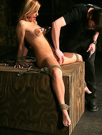 Ginger is tied in the dungeon. : Slave Ginger is a sweet, submissive, southern belle with a beautiful body and gorgeous blue eyes. Standing naked in the Dungeon, Ginger is greeted by The Pope who fingers her pussy deeply before he gets to work on her little body with his flogger. Ginger gasps as she takes her licks and then, the heat is turned up when her nipples are clamped and weighted. The pain then intermingles with pleasure as The Pope works her pussy with the wand and grants his slave permission to cum...