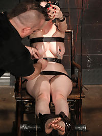Sybil has her massive tits clamped! : We invited Sybil back for another day of tough scenes, this time with Bane and she was happy to answer the call...Ive gone on about the joys of working with Sybil before, but she is a true professional BDSM model, of which there are very few...she has an amazing body and is always ready to be flung into a sincere headspace...Bane locks her into the first position, crudely bent over, Sybil first has to deal with the prospect of being locked in a very uncomfortable position as the stone-faced Bane has his way her...He really has a fondness for the small stinging tools...the wire slapper, the small plastic flogger, the cane...these are some of the least daunting, but most severe instruments ever used on human beings...the feeling of the wire slapper has been compared to the sting of a single tail crack...and it leaves marks as such...Bane leaves her ungagged throughout and sometimes, Sybil has to talk her way through...its like hearing her inner dialogue...and it sounds quite desperate from time to time...In the second scene, Bane sets up a predicament with weights and electricity...Ive never gotten so aroused just watching someones shoulders give out from exhaustion...and when they do, she gets a strong shock to the back of her calves...Bane taunts her feet, encouraging her to fail...and she does...Ogre...