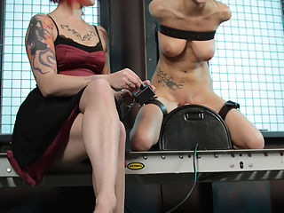 Big tits restrained and cumming! : Restrained to the Sybian, April exclaims as Soma pins her nipples. Her Goddess voices her approval as the drool drips from Aprils mouth. The whip hits her tits and she begs for mercy but, Soma has a different strategy... The Sybian is propelled into gear and Aprils tits heave. Her body buckles as it is swept by an orgasmic tidal wave. Her screams careen off the Dungeon walls and this is merely a prelude of what is to come... Mentally spent, April realizes her journey shall continue onward as she is locked and stocked tightly in place. Her pussy is stuffed and her body is pushed towards the breaking point...