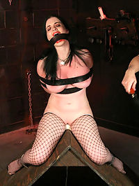 Big tit slave! girl on girl bondage! : Sybils ordeal begins as she is chained to the wall... She opens wide for the Goddess and her massive breasts are clamped tightly. She exclaims in pain as her nipples are stretched. Her pussy sops as she is vibed to a whimpering orgasm and then the pain factor is turned up a notch. Crotch roped and weighted, Sybil begs for mercy. She comes to the bitter realization that this has only just begun...