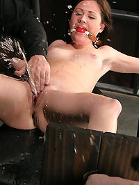 Squirting bondage slave orgasms! : Head harnessed and chained, Sindee first meets her Master as he gropes and paws her tight little body before he breaks out his whip. Quickly her flesh reddens and she thanks Big Bad for his attention. Her first orgasm comes fast but, merely serves as a prelude to the days events. What we then witness as the day progresses is a mind boggling display or massive, spouting, soaking orgasms as Sindee squirms her way through multiple positions of restraint and squirts so much we should have all worn raincoats...