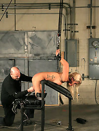 Hot blonde in strict restraint! : This week we welcome foxy Bridgette B. to Strict Restraint. Weve featured her on our other DungeonCorp sites and we were thrilled to have her make her debut here. Bridgette has a sweet body and she loves bondage. Eager to get started, Big Bad confined his slave in steel cuffs and a head harness and the fun begins... Beautiful Bridgette proved to be a loyal servant to her Master as her body was put to the test. Locks, stocks, shackles and vibes were the order of the day. And it all culminates in mind blowing fashion as Bridgette is tightly restrained while she gets fucked soundly by the Cumbots as her Master has his dastardly way...