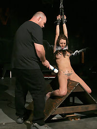 Shackled and mistreated. : Skyler is abruptly wheeled in by Big Bad on the rolling rack and then receives an immediate and painful flogging across her torso and pussy. Her filthy mouth is stuffed with a rubber dong while she proclaims her whorishness and the bitter flogging resumes. Her swollen pussy is fingered and the magic wand is then pressed against her bulbous clit and Skyler gives in and cums...