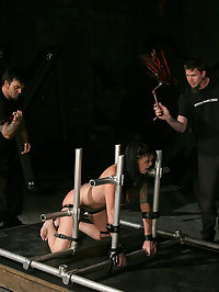 Krissy is taught her lesson by Master Liam. : Chained and restrained, Krissy is naked and bare, hoisted high on the bars. Her mouth is taped shut by her Master and then the flogging begins. While the floggers strike her supple flesh, we witness Krissys skin evolve from a pale white to a deep, glowing red. Then, the magic wand is pressed against her pussy and Krissy orgasms for the first time... Strapped to the bars, Krissy whimpers as she is greeted by Master Liam. He then cranks up the violet wand and Krissy exclaims as the electricity ripples across her bare body.