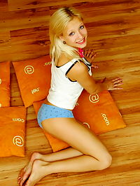 Amazing blonde nude teen decided to place herself at the attic of her wooden house on four orange pillows for her dirty intention.