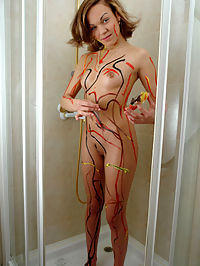 Girl locked in the bathroom and painting her nude body with different colors