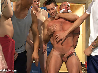 Handyman with a big cock gets tied up and used by horny dudes in the locker room. : Handyman Ethan Ayers is working in the locker room and the horny guys are looking at him. They pull him away from his power tools and take him down. A couple of dudes rip off his clothes and discover that he got a huge dick. Ethan tries to fight back but hes no match for a locker room full of dudes. They fuck him with his own power tool and shove an electric butt plug up his ass. Ethan endures brutal gang bang and made to lick cum off the nasty floor.