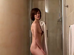 Horny wife rubbing her pussy under the shower