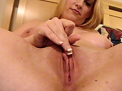 Big boob blonde girlfriend grabs her cam to film herself playing with her wet pussy lips