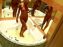 Blonde teen with long legs gets comfy in her bath and fucks a dildo while a secret camera rolls.