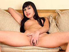 Slender brunette Galechka peeks through a sheer lavender top and black thong until spreading ass cheeks and revealing a bald pussy, fingers and dildo