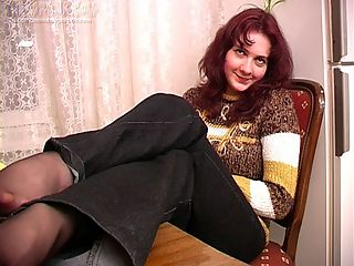 Olga is wearing a sweater and drinking like a fish as this video stars. Her tits look great in the soft wool and under her pants shes wearing nylons that are alluring even if we can only see her toes. Olga gets drunk and when the alcohol is really flowing through her she stands and does a striptease. Shes a little woozy on her feet but thats precisely why shes getting naked so we love it. She ends up stripping down to just her stockings and then she fingers her pussy and shows us those beautiful natural tits that sit on her chest. She also fingers her dripping wet hole