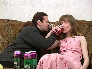 Ivan and Nelly are enjoying wine coolers that are made specifically to get a slut drunk and the chick drinks down as much as he gives her. The more he pours the more she drinks and when he peels a banana for her to eat she cant help but oblige his naughty desires. When a chick chews a phallic fruit in such a lusty manner its bound to get a guy all excited and aroused. A little more liquor and hes ready to make his move with this sexy slut. She gives him head and then he pounds her pussy missionary and doggy style. Its great drunk hardcore sex for sure