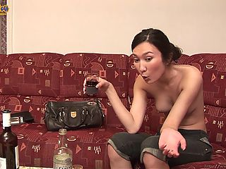 Sexy Suong has drinks, fruit and chocolate candy in front of her and shes having a little solo party. Her favorite thing is the booze and the more she drinks the more fun she seems to get. She goes from being a little bit uptight to totally loose and slutty. She drinks a full bottle of wine and then she moves on to the hard stuff so she can get fully loaded. Her top comes off at some point and her all natural tits are breathtaking. Theyre perky and tight looking and they will surely inspire arousal deep in your dick. There are fully naked shots in there as well