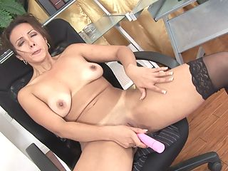 Naughty milf professional takes a break to pleasure her pussy