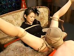 Hard BDSM Bondage Sex : This is part 1 of a two part bondage movie starring Maki Tomoda. Watch this sexy JAV model tied up with a tight rope and abused while immobilized. See her hung upside down while her master make sweet love and punish her painfully.