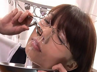 Bukkake Schoolgirl : Ibuki Haruhi receives bukkake cum facials while tied up and with ball gag and nose clip.
