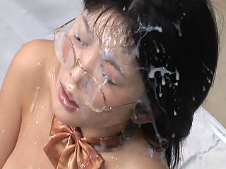 Bukkake Schoolgirl : Yuria Hidaka in her school uniform receives messy bukkake cumshots on her clothes hair face and body.