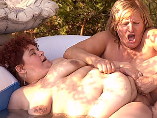 Finger Banged Lesbian BBW : Rosza and Jessica are mature bbw with massive chunks of fat covering their lusty bodies. In this outdoor fat sex scene we have them go at it with each other and pleasure their fatty eager pussies by eating them out and cramming them with their fingers.