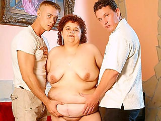 Horny BBW Threesome Sex : Big, fat and horny milf Gaborne is a cock hungry bbw, always craving for dicks to gobble with her lusty mouth. Watch her as she gets pampered by two horny chubby loving studs, watch her slobber their dicks with gusto before taking it in her dripping wet cunt.