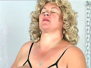 Older Blonde Fatty Grace : Grace really needs some huge cock but she has been too busy to hook up with a gorgeous guy. Her big tits are looking for some attention and her bald pussy really needs some hard loving. Good thing, her fingers are plump enough to fill her chubby cunt to orgasm.